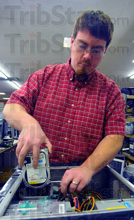 Reuse: Brian Scott refurbishes a computer at Goodwill. Indiana State University and Goodwill are two centers where outdated electronics can be donated for refurbishing or recycling.