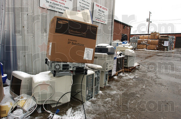 Piling up: Assorted electronics stand piled up at the Indiana State University recycling center Thursday afternoon.