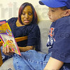 Quality time: Paige Malone reads to Fuqua kindergarten student Gunnar Langer in the Hyte Center Thursday evening.