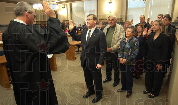 Promises: Judge Michael Lewis swears in Vigo County porsecutor Terry Modesitt and his deputies Thursday afternoon. Mdesitt was elected to second term this past November.