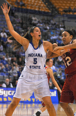 I'm open: Shannon Thomas fends off a SIU Edwardsville opponent with one arm as she calls for the ball.