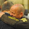 Thanks: Sheriff Greg Ewing gives a hug to Judge Chris Newton after Newton administered the oath of office to the new sheriff.