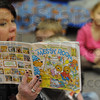 Day care: Barbara Davis, teacher at the Maple Avenue Church Day Care Center reads a book to her kids Thursday morning.