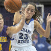 Ball battle: Northern Iowa's #3, Rachel Madrigal and Indiana State's #23, Taylor Whitley fight for a loose ball during first half action Thursday night at Hulman Center.