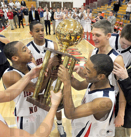 Trophy time: Terre Haute North players receive the 2010 Pizza Hut Classic tournament trophy after beating Northview in the final game.