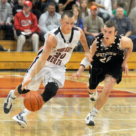 Drive: Terre Haute North's #20, Logan Shipley pushes the ball upcourt as he's being defended by Northview's #22, Trent Lancaster during the Pizza Hut Classic final Thursday night.