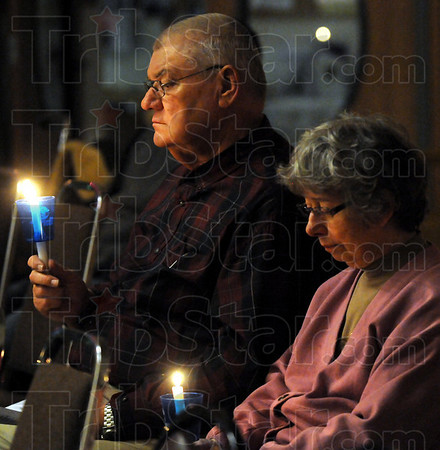 Remembering: Jim and Lila Waugh hold a candle to honor their daughter who was killed by a drunk driver during Sunday's event.