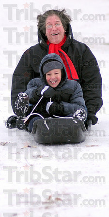 Law of gravity: Broz Gilson and his mom Cariline sled down Snow Hill in Deming Park Sunday afternoon.