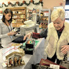 Stocking up: Steinmart customer Joanie Sauer spent a portion of Sunday shopping for needed items at Steinmart's After Christmas Sale. Cashier Jennifer Bensinger registers the items.