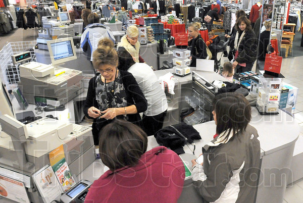 Busy: Cashiers were kept busy at Steinmart Sunday afternoon as people took advantage of After Christmas Sales at the eastside department store.