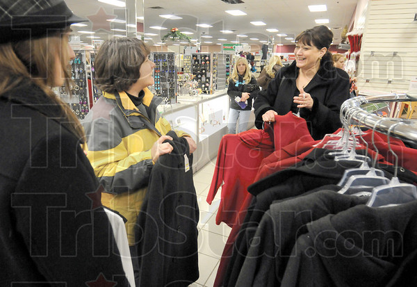 Shoppers: Kira Adams, Vicki Adams and Karen Buchholz take advantage of an After Christmas Sale and shop at Steinmart Sunday afternoon.