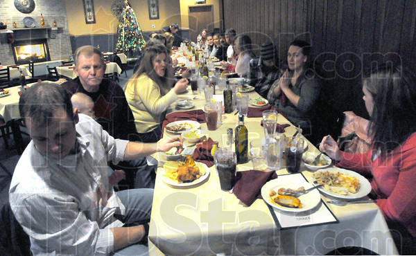 Family: Michael Delaunois (L) enjoys a dinner with 35 family members Sunday afternoon at The Tuscany Restaurant.