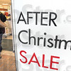 Let's go shopping: A customer enters Steinmart for an After Christmas Sale Sunday afternoon.