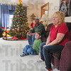 At home: The Herricks; John, Reed and Lynn in their Rockville home, talk with Tribune-Star reporter Brian Boyce about their all-out decorating.