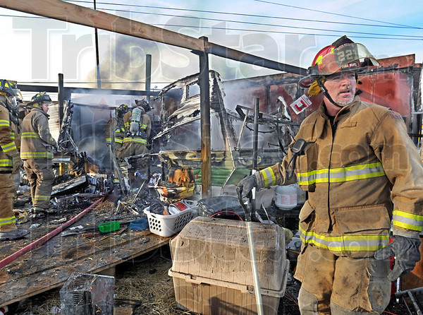 Destroyed: A small mobile home was destroyed by fire at Otter Creek Tire company Friday afternoon. Otter Creek volunteers extinguished the blaze in minutes after arrival.