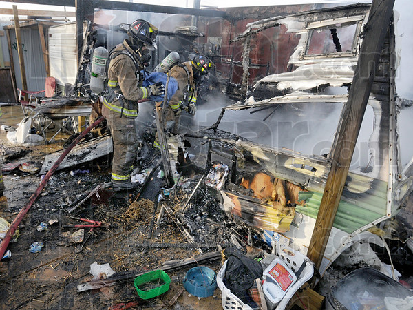 Total loss: A small camper sized mobile home was destroyed by fire at Otter Creek Tire Friday afternoon.