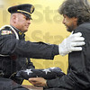 Emotional: Terre Haute Police Chief John Plasse consoles former K-9 officer Dan Parker as he presents him with a flag honoring Rambo.