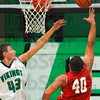 Up there: West Vigo's Ryan Crowther(43) alters the shot of Brave Jeffery Turner in first half action Friday night in the Viking's gym.