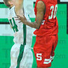 Nothing's easy; Zach Lyon(44) challenges a shot by Terre Haute South's Jermaine Smith(30).
