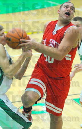 Stripped: Terre haute South's Jeffery Turner(40) has the ball stolen as he attempts a layup by Viking Ryan Crowther.