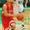 Upcourt: Brave Anthony McGill pushes the ball upcourt as West Vigo's Ryan Crowther gives chase.