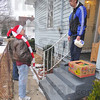 Merry Christmas: Rod Henry chats with Earl Stahl after delivering a food basket to his home Friday morning.