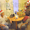Gratitude: Daryl Gasaway expresses his gratitute to Rod Henry after recieving a food basket. Henry and his wife Benita took time out Friday morning, along with dozens of other volunteers, to load and deliver some 440 Tribune-Star Christmas baskets.