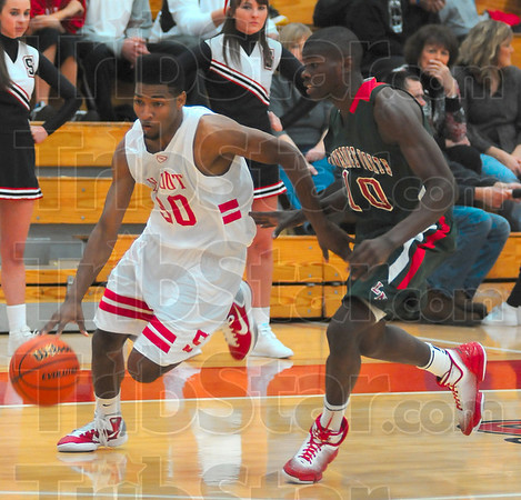 Stepping out: Brave Jermaine Smith gets a step on Wildcat defender Eron H arris as he drives to the hoop.
