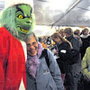 Grinch: The Christmas Grinch greets people during the Miracle on 7th Street event Friday night.