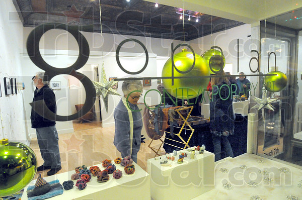 Gallery goers: The Gopalan Contemporary Art Gallery was one of the sponsors for the Miracle on 7th Street event in downtown Terre Haute Friday night.
