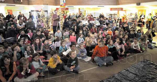 "Library: A large group attended the ""Arround the Tree"" celebration with live reindeer Friday afternoon at the Vigo County Public Library."