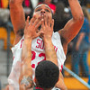 Tight defense: Derik Shouse shoots past the pressure of Lawrence North defender Brandon Muncie.