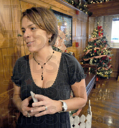 "Reception: Local film producer Cathy Spelman Rubey talks about her movie ""Holiday Baggage"" with Tribune-Star reporter Brian Boyce prior to a reception at the Clabber Girl Museum Friday night."