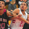 Contact: Lawrence North forward Brandon Muncie(20) and Brave Derik Shouse(22) battle for positionfor a rebound.