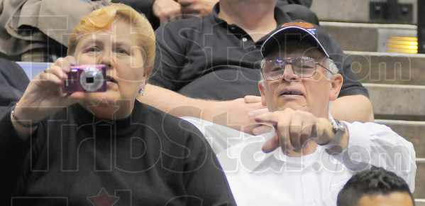 There she is: Sharrie and George Kress, parents of ISU graduate Megan Kress, locate her in the sea of blue on the Hulman Center floor.