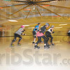 Faster: Speed is an integral part of Roller Derby. Here members of the Clobber Girls team warm up with laps around the rink before they work on specific skills, such as how to safely land on the hard floor.