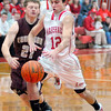 Breaking away: Lion Thomas Sisson(12) tries to stay ahead of Maroon defenderWarren Whithaus(21)after a steal.