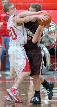 Relentless: Logan Cannady(30) ties up Maroon Zach Danks on the sideline early in their game Saturday night in the Lions gym.