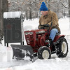 Snow man: Rocky Nelson clears the sidewalks around Collett Park with his antique Wheelhors snow plow Christmas Day.