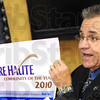 We are: Rod Henry holds the newly designed Terre Haute logo during the announcement that Terre Haute was named the Indiana Chamber's Communit of the Year.