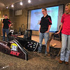 Best around: Human powered vehicle team members Patrick Woolfender, Petras Swissler, Ethan Rockett and Claire Stark talk about their vehicle and their accomplishments with it at a Saturday presentation at the Terre Haute Children's Museum. The team brought back several trophies from international competition.