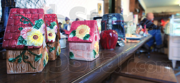 """Something for everyone: Ceramic birdhouses line a table in """"Another Man's Treasure"""", a re-sale store run by Lynn  and Karen Allen."""