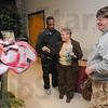 "Teacher teaching: Karen Page, associate professor in Visual Communicationsa at IVy Tech State College, center, talks with two of her Photoshop students Paul Ware and Jon Ludwig about the recycled art projects. The palm tree, titled ""Beauty of Nature"" was made from printing plates and paper by South Vermillion High School students Savannah Klinge and Michelle Pepelea"