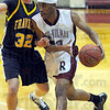 Looking: Rose-Hulman forward Nate Gissentanner(33) looks for an open teammate as he drives against Bear Bryant Conder(32).