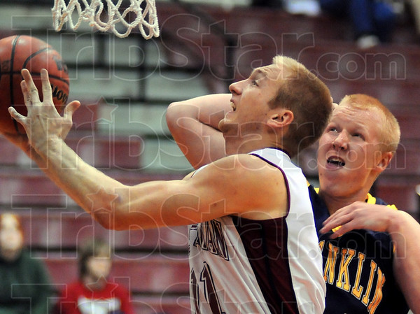 In close: Engineer Jason Haslag looks for a layup as Franklin's Zach Mersbrock tries to avoid a foul.