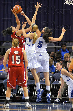 Swat team: SIU Edwardsville's alyssa Decker has her shot blocked by Shannon Thomas. In with Thomas is teammate Moriah Hodge. Watching are Decker's teammate Valerie Finnin(15) and Sycamore Taylor Whitley, lower right.