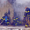 Extensive: Terre Haute city firefighters work to extinguish a blaze in a home on South 21st street Wednesday morning.