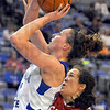 Going in: Kelsie Cooley shoots from the paint past SIUe defender Sydney Stahlberg,