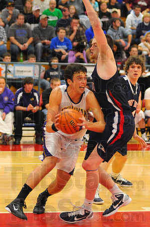 All night: Rhett Smith was faced with Justin Gant or calvin Blank all night long.  Here Gant block his way tot eh hoop.