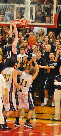 Crowd pleaser: The Terre Haute North student fan section reacts to a late Justin Gant dunk while Sullivan defenders can only watch or get out of the way.